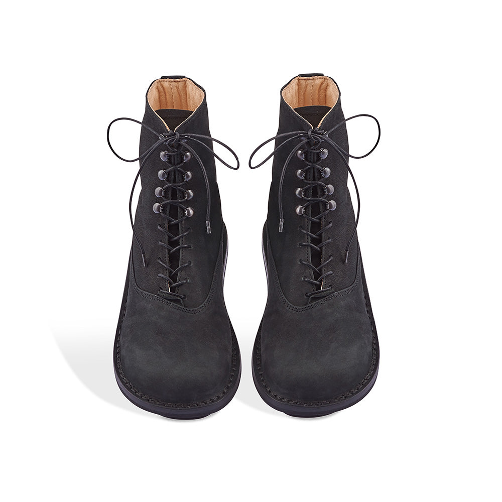 Mascha is a functional ankle boot handcrafted in gorgeous leather with a brushed nubuck upper. An accommodating fit with hook lacing above the ankle, this rugged boot is perfect for keeping warm and stylish through winter.