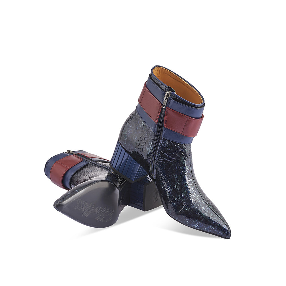 A stunning boot in John Fluevog's Effortless family, the Miranda features a sharp yet accommodating toe shape, oversized acrylic buckle and a dazzling blue metallic leather upper with a high gloss finish. This surprisingly comfortable winter option will turn jealous heads wherever she goes!