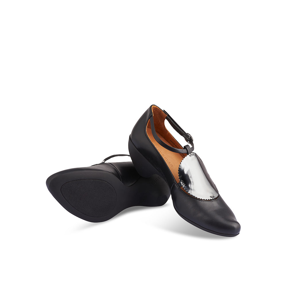 Set on Tracey Neuls' signature sculpted rubber sole, Missy has a supple black leather upper with an opulent reflective leather disc detail. The soft leather lining feel beautiful on the foot and the fine leather strap adds to the timeless elegance of this versatile heel.