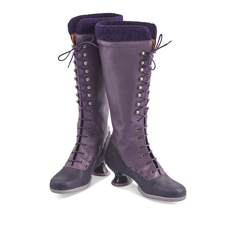 Our first knee-high boot from John Fluevog's popular Enneagram family, the Optimist is a cheerful winter-ready option with graceful details throughout. This beautiful boot features rich contrast purple tones, a cute wool felt collar for extra warmth and a shapely mid heel that's both and eye-catching and unbelievably comfy.