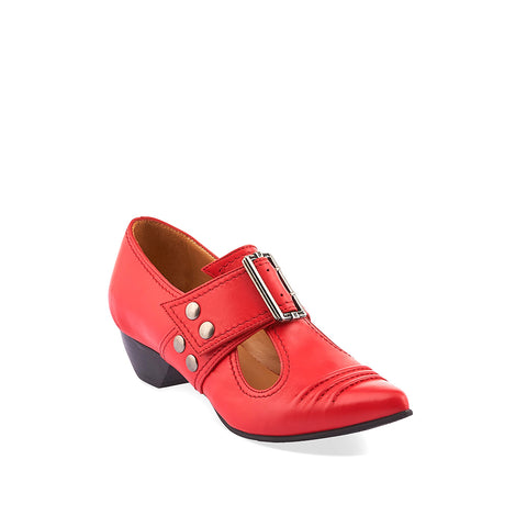A pointy-toed t-strap loafer, the Pilgrim shoe was one of John Fluevog's first women's designs which took its initial inspiration from the Victorian era. This updated design includes a comfy rubber sole, custom silver buckle, low leather-wrapped heel and specialty leathers that will age beautifully over time.