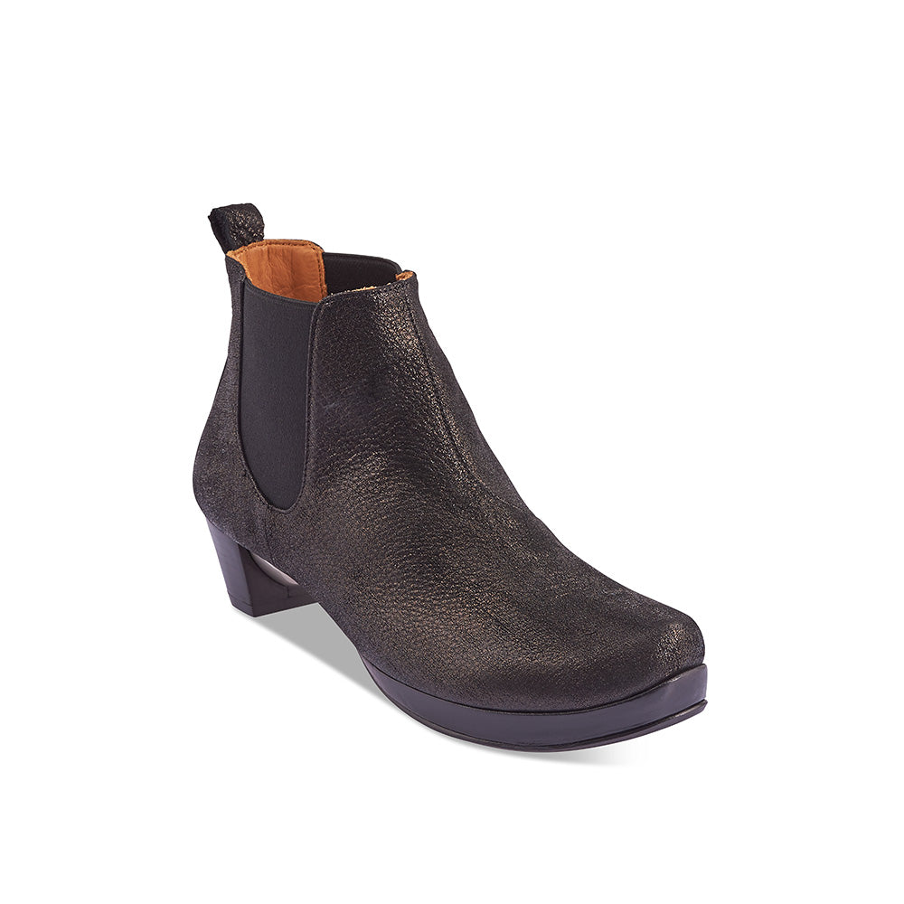 A modern interpretation of the Chelsea boot, Prince by Tracey Neuls has an easy fit that incorporates a subtle platform for extra comfort. The brushed leather upper glistens in the light and feels amazing on the foot, while the leather sole features a beautiful silver orb detail under the heel.