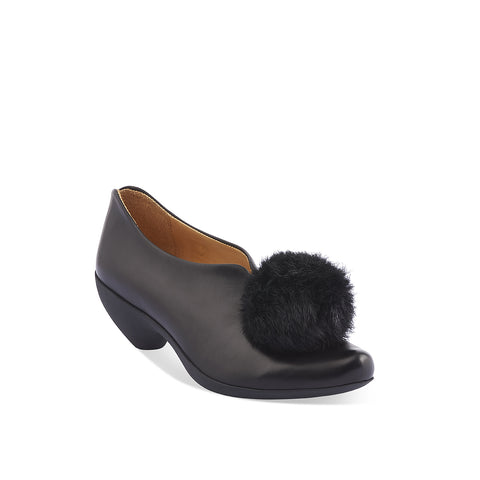 The exuberant Puffball returns to soleDevotion with its playful attitude and gorgeous design lines. The supple leather upper features a faux-fur pom-pom sitting joyfully above the foot and the slip-on design makes it an easy and accommodating fit. Tracey's signature sculpted toe and shapely rubber heel add to the everyday comfort of this remarkable shoe.