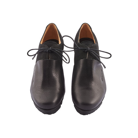 With a sculptural silhouette and overlapping leather sections, Rapid is a chic modern lace-up by Trippen. The soft yet durable contrast leather upper will age beautifully with wear and the textured wedge sole ensures comfort underfoot and a little extra height without compromising balance and stability.