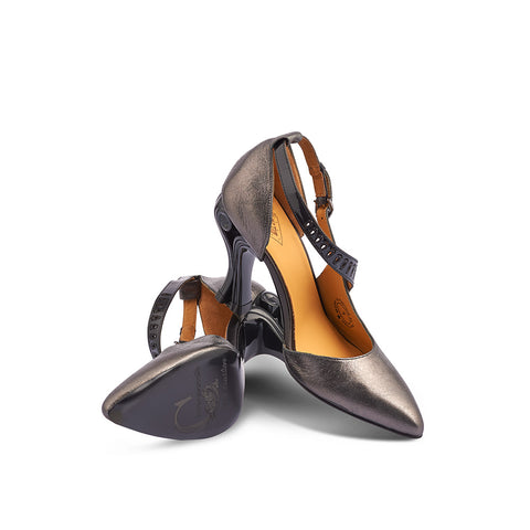In opulent pewter and patent black, the daring Andromeda features a 4-inch scrolled heel and lasercut details on the fine ankle strap. The sharp toe and slim silhouette perfectly complement her dangerous, sweeping curves and femme-fatale look.