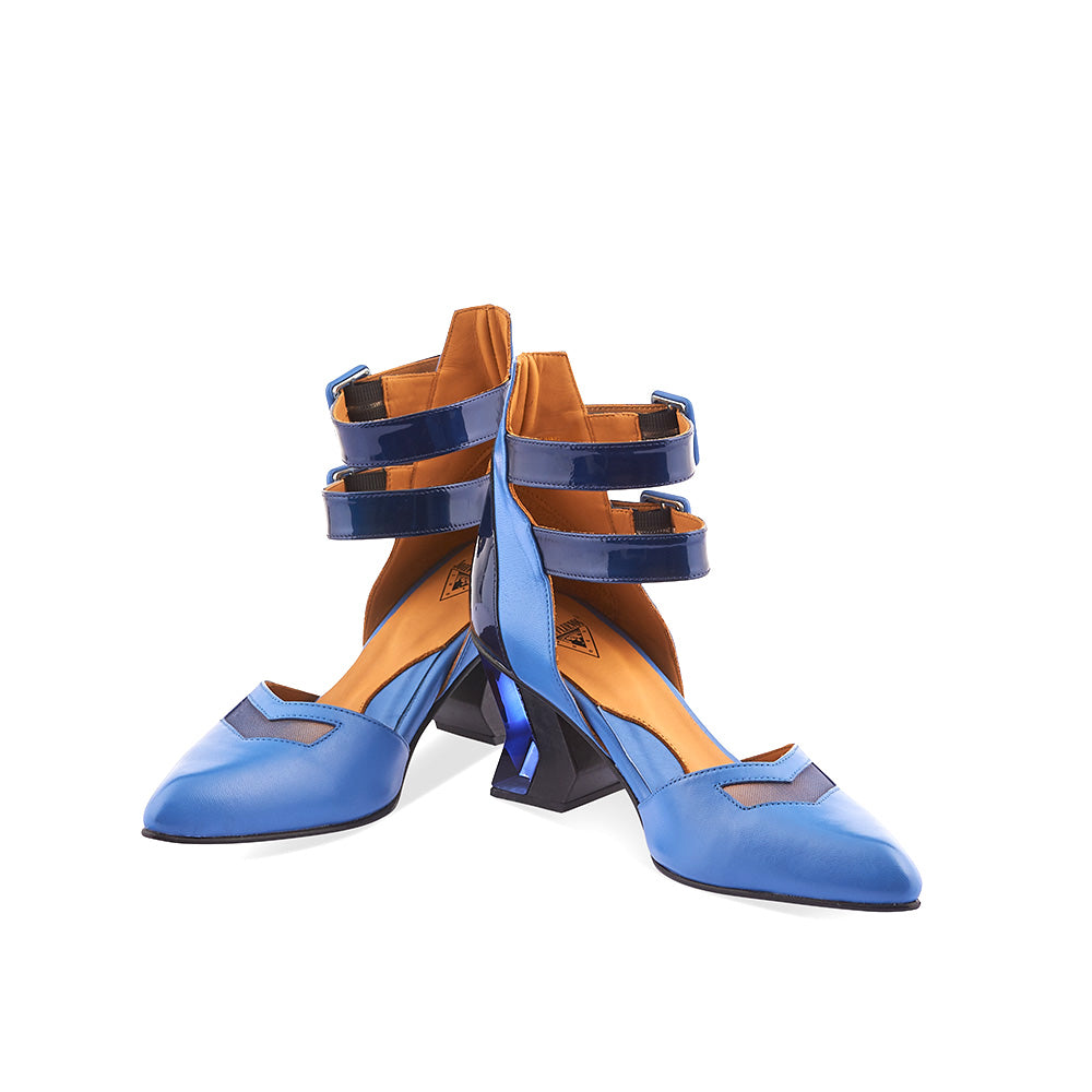 We suspect people from all walks of life will appreciate the beauty of John Fluevog's all-new Slant. More than a touch off kilter from your average party shoe, these angular keepers feature double ankle straps, leather-wrapped buckles, a sexy mesh cutout on the toe and a crazy unique bolt-shaped wood and acrylic heel. Light speaks… Listen!