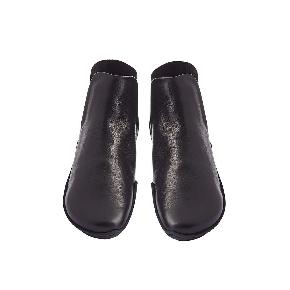 This sporty yet refined ankle boot from Trippen features an elastic section that wraps around the heel for a snug, very comfy fit. The soft leather lining and supple black leather upper combine for winter readiness and the textured rubber 'wave' sole is complemented internally by a contoured leather footbed providing arch support.