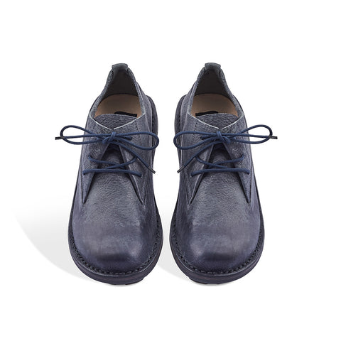 This modern lace-up is crafted in Trippen's new 'grey ash' hand-finished leather for rich textural appeal. Providing both height and comfort, the lightweight rubber wedge sole features textured grip and plenty of flexibility underfoot.