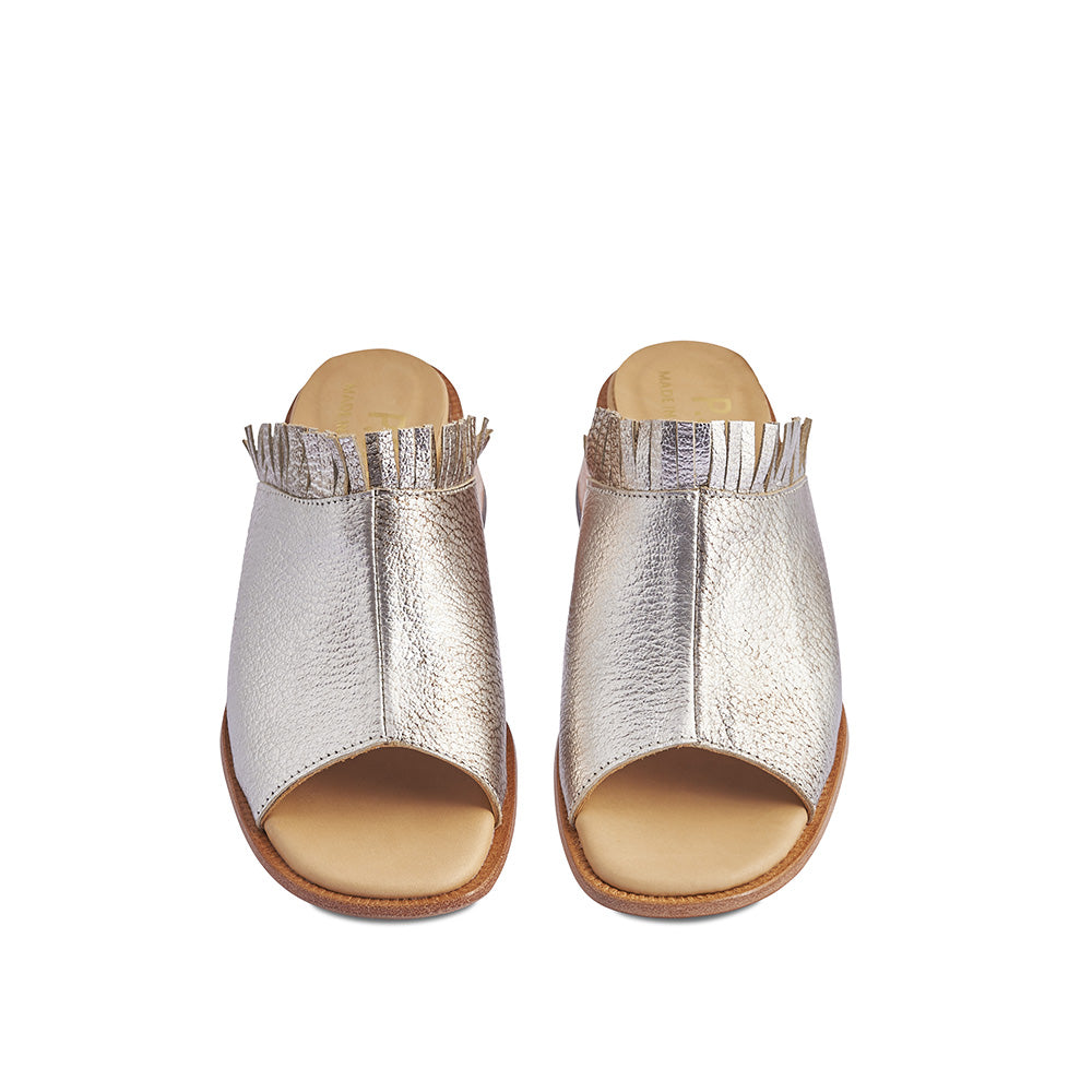 In shimmering metallic, this chic summer mule features a playful fringe detail and a supple leather upper. Handcrafted in Melbourne by Post Sole Studio, the sculpted wedge heel provides a touch of extra height and the soft leather insole ensures comfort on the hottest of days.