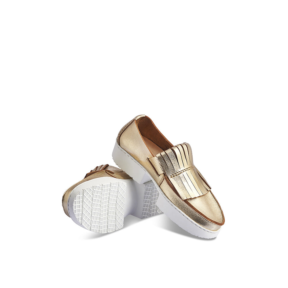 Tiger is a chic contemporary take on the traditional loafer. This metallic slip-on retains the classic kiltie detailing but pairs it with a modern and sporty block sole - genius! The contoured leather insole provides support and the solid yet flexible rubber sole wears exceptionally well while providing an intriguing silhouette.
