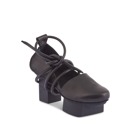 This eye-catching platform heel by Trippen has a supple unlined leather upper and cushioned leather insole. Banish features a leather-wrapped cord that runs around the ankle and under the sole, securing above the foot for an perfect fit on any foot.