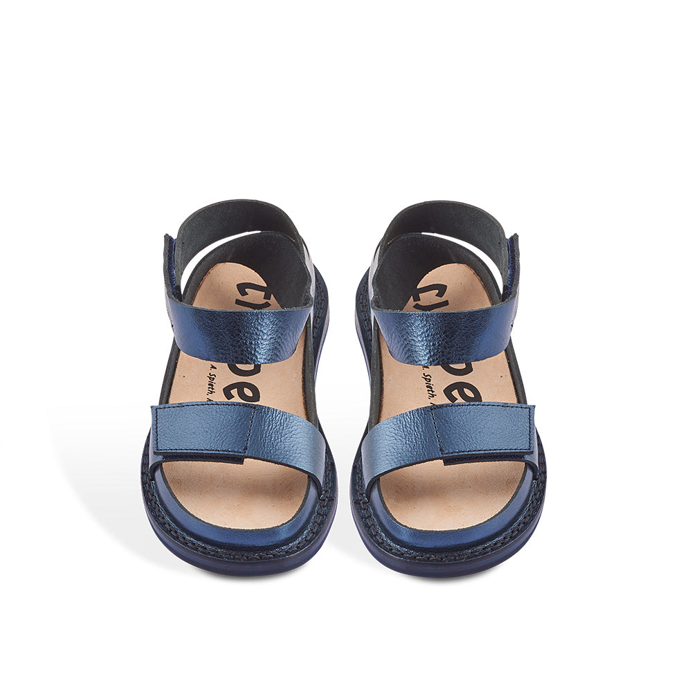 A new Closed sandal from Trippen, Canal has minimal coverage and two adjustable straps for the perfect fit. Handcrafted in supple leather with a dark metallic navy finish, this versatile sandal sits on the flexible 'Stick' sole and features a contoured cork and leather insole for optimum support underfoot.
