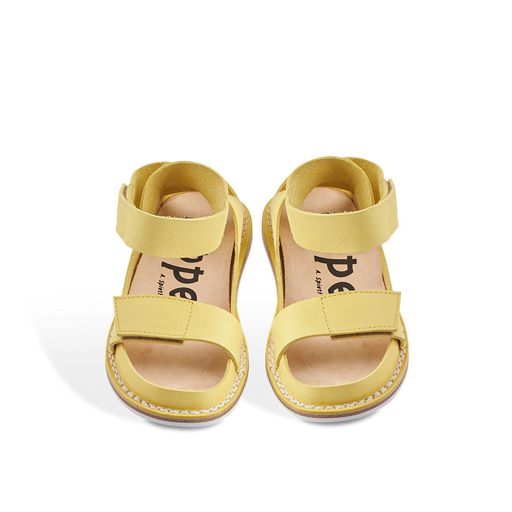 A new Closed sandal from Trippen, Canal has minimal coverage and two adjustable straps for the perfect fit. Handcrafted in the most supple yellow leather, this versatile sandal sits on the flexible 'Stick' sole and features a contoured cork and leather insole for optimum support underfoot.