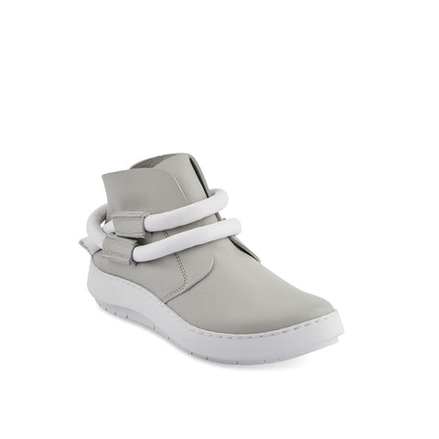 A luxe modern sneaker on Trippen's new Swan sole, Dew's soft leather upper features a contrast leather cord that wraps around the ankle and can be tucked in at the heel. Dew has a wave-shaped sole and a supportive contoured leather insole for all-day comfort.