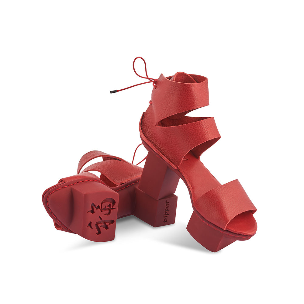 Sitting fiercely atop Trippen's new red Happy sole, Fancy in sumptuous red leather has an easy fit secured by a lace at the heel. This bold custom creation is surprisingly sturdy underfoot and the striking silhouette is unmistakably Trippen.