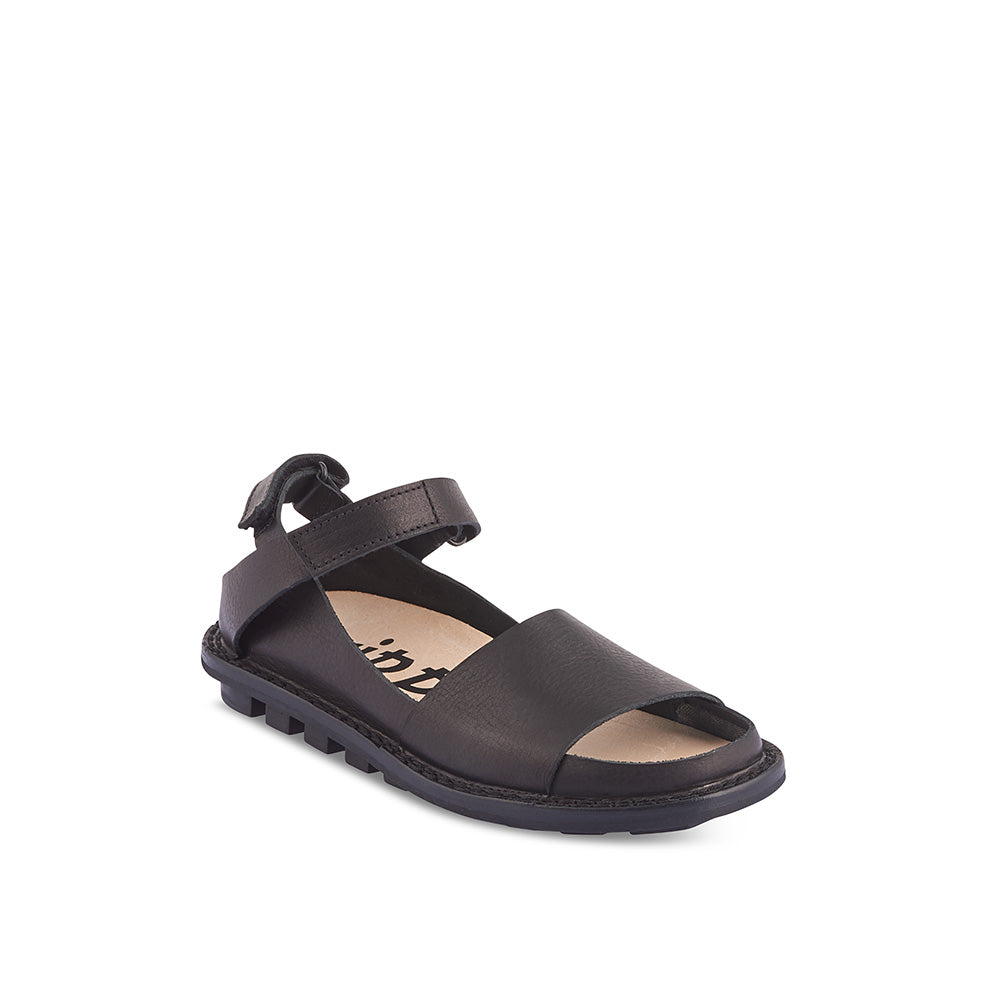 Handmade in supple black leather, Fez is the chic all-purpose sandal we've been waiting for. This versatile summer option features a flexible rubber sole, contoured cork/suede insole and two adjustable velcro straps at the heel for the perfect fit.