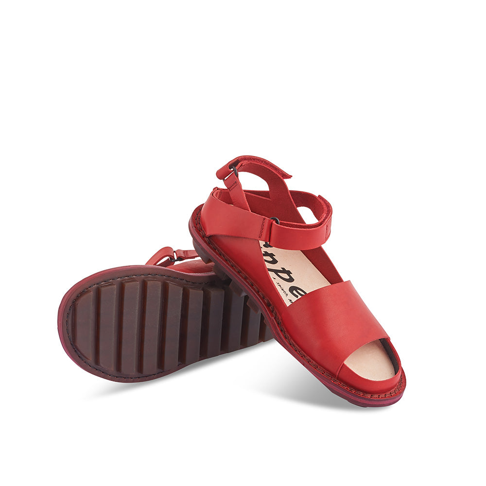 Fez by Trippen is the graphic red sandal we've been waiting for. This versatile summer option features a flexible rubber sole, contoured cork/suede insole and two adjustable velcro straps for the perfect fit at the heel.