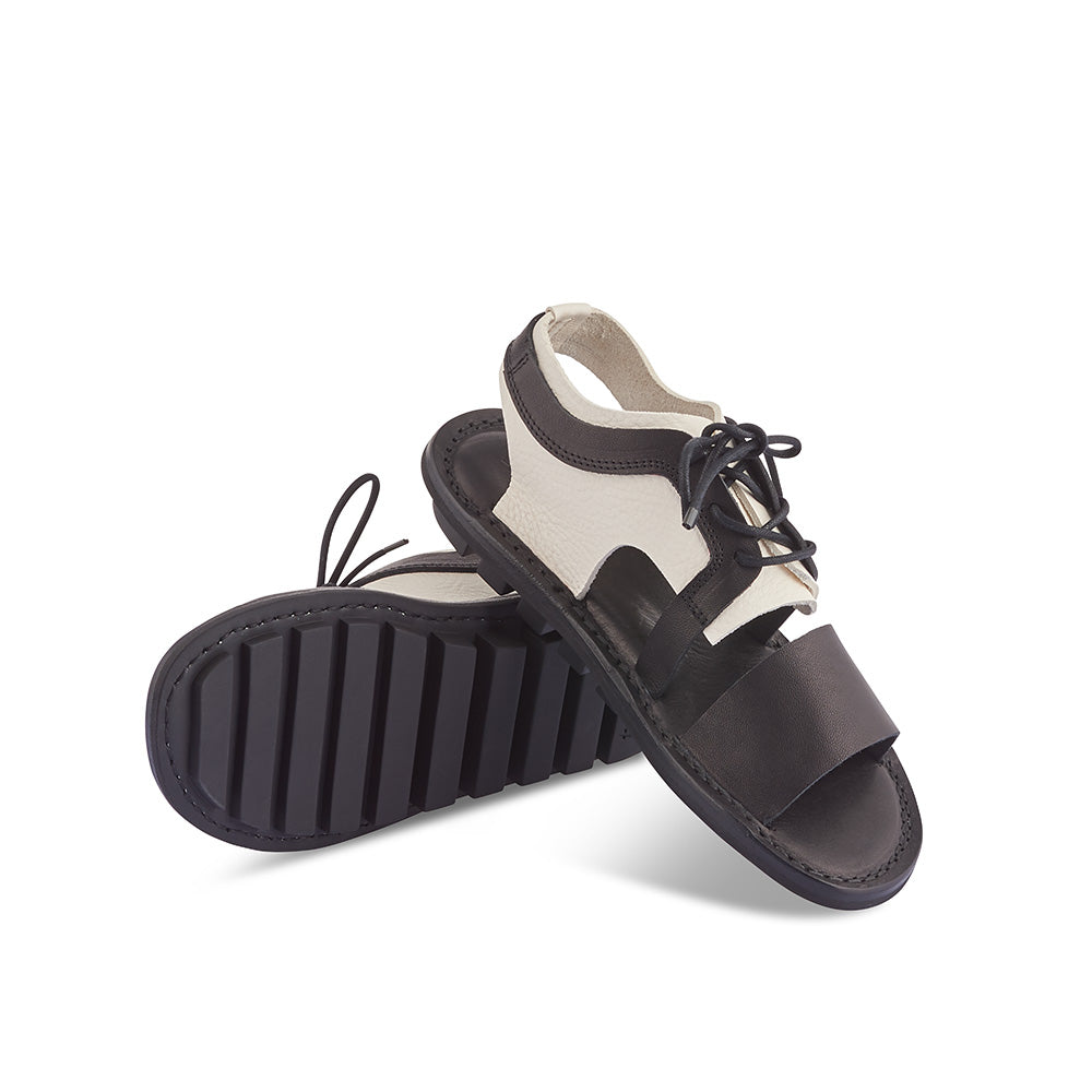 In chic monochrome leathers, Rack is a sandal/derby hybrid with an intriguing silhouette and a flexible yet sturdy rubber sole. The laces ensure a great fit on any foot, while the open sections allow for breezy comfort on the hottest of summer days.