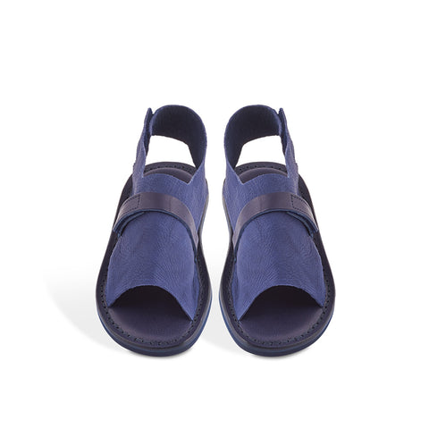 Simple slides don't get more luxurious than this. Handmade with a soft elk leather upper, this versatile summer option cushions the foot from all sides. Fastening with two velcro straps, Trippen's Sandal is effortless, sporty and chic.