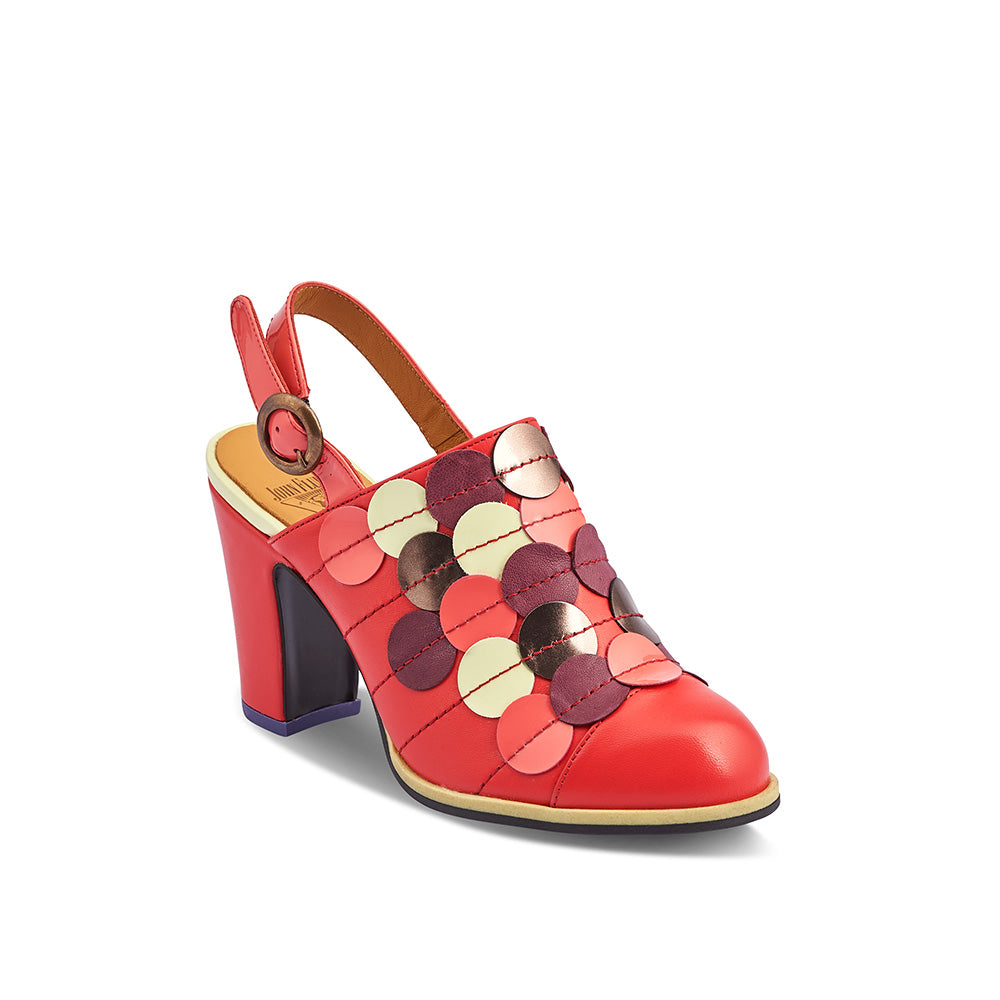 Meet Tziporah, a bright and lively slingback from the ever-astounding John Fluevog. The rich coral red upper is elevated with a multicoloured elliptical motif and finished with a patent strap and brass circular buckle.