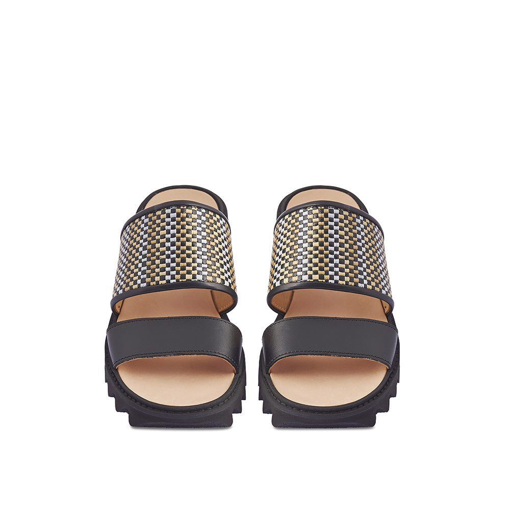 Set on a super-comfy rubber ripple sole, this summer slide features a woven leather and raffia upper with a slim leather front strap. Handmade by Melbourne's own Post Sole Studio, this versatile slide is just at home out in the city or relaxing at the beach.