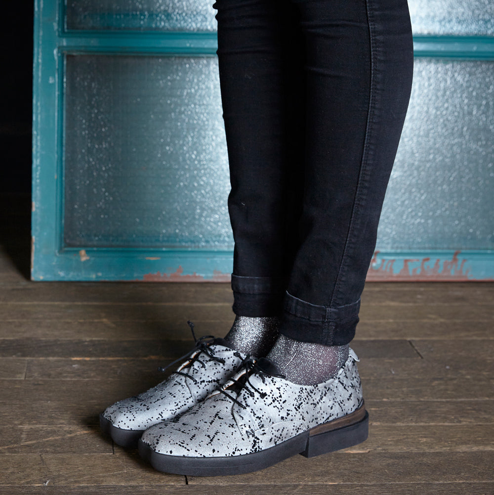Tracey Neuls' Dean features a luxuriously soft, silvery leather upper with a fine flocked felt finish. The signature heart-shaped toe meets a chunky yet lightweight rubber sole and leather lining to create a lace up that's as comfy as your favourite trainers.