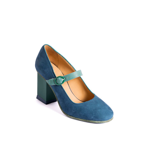 With a modern block heel and soft suede upper, Joanne is a step in a new direction for John Fluevog. The well balanced heel provides stability underfoot, making this an easy to wear shoe despite its 3-inch height.