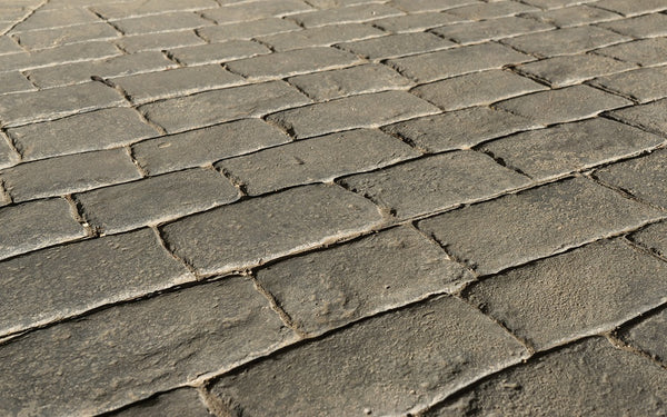 How to Remove Snow from Decorative and Stamped Concrete Walkways and Driveways