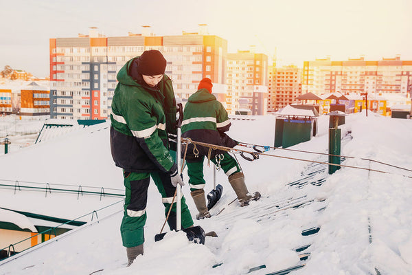 Staying Safe When Removing Snow and Ice from Your Facility's Roof