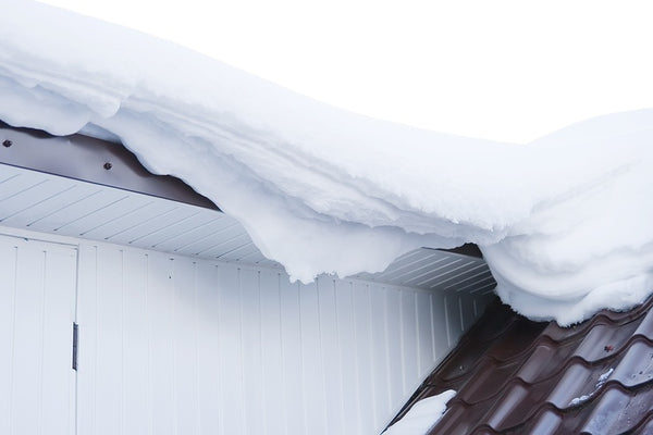 The Safest Way to Remove Snow from Your Roof
