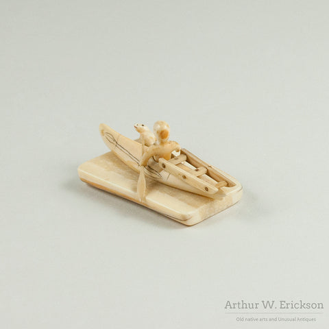 Eskimo Carved Ivory Man in Kayak hunting Seal