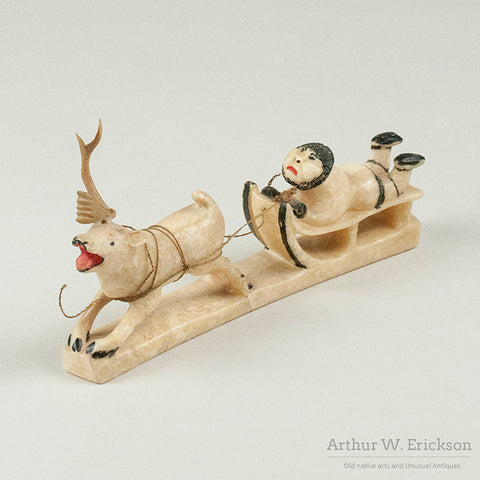Eskimo Walrus Ivory Carving of Sled rider and Reindeer