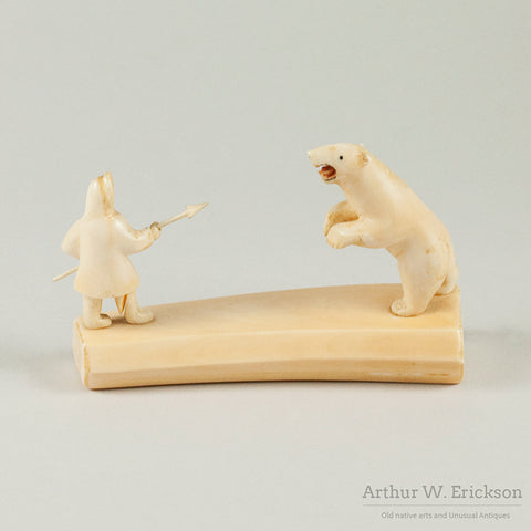 Ivory Stand-off Between Polar Bear and Eskimo Hunter