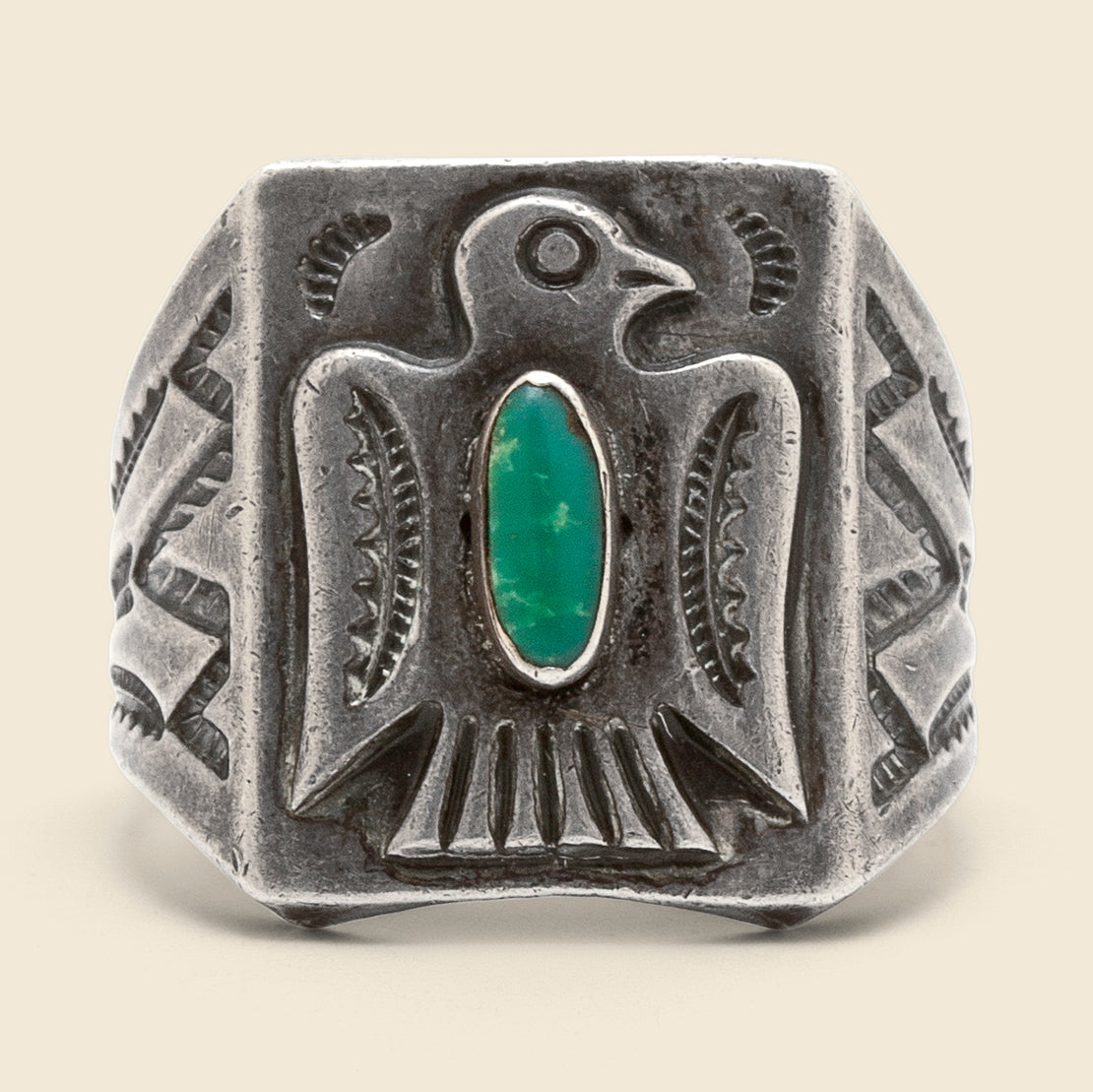 Stamped Thunderbird Oval Turquoise Ring - Sterling
