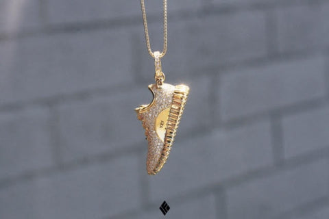 gold and silver shoe necklace