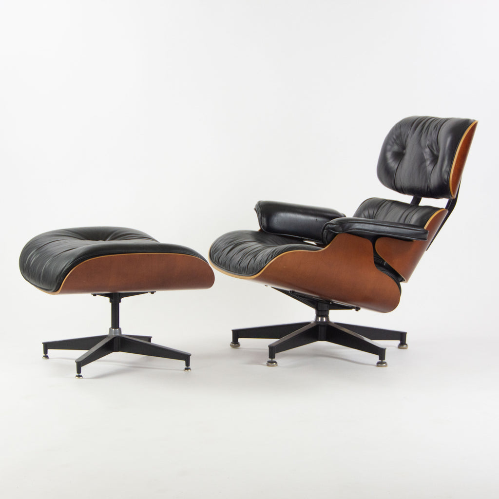 SOLD 1990s Herman Miller Eames Lounge Chair and Ottoman Cherry Black Leather 670 671