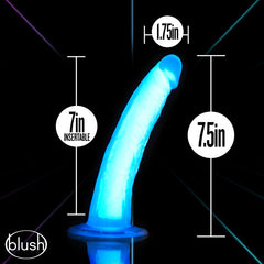 dildo on a black background showing it glowing and surrounded by measurements