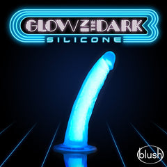 on a black background with a sign that reads 'Glow in the dark'