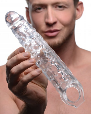 Clear 3 Inch Penis Extender Sleeve held by a male model