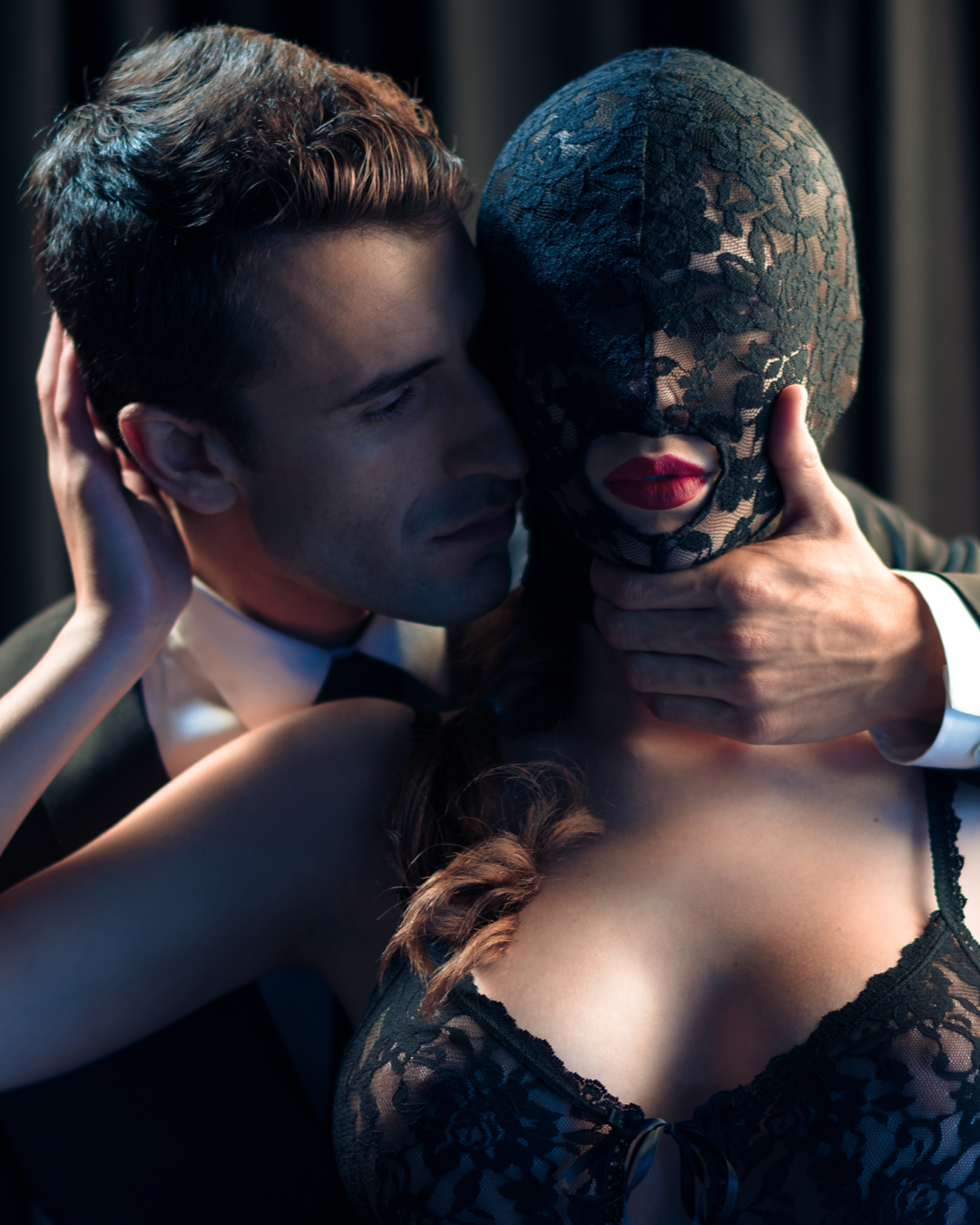 Scandal Lace Sensory Deprivation Hood - Black on model with man holding her chin