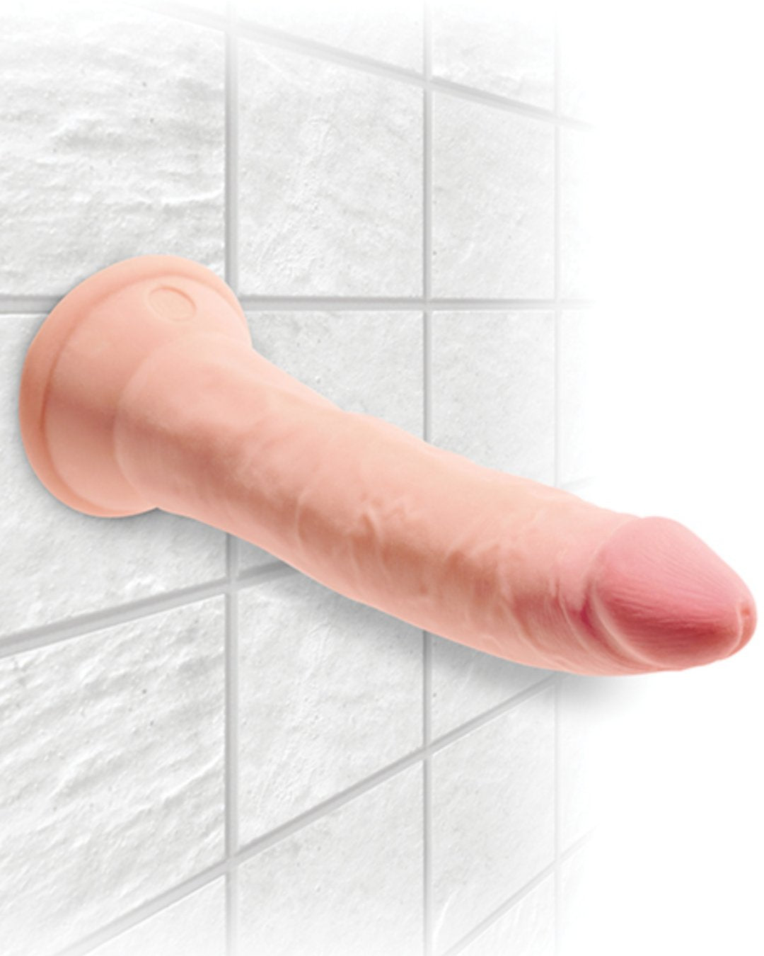 King Cock Plus Triple Density 7 Inch Suction Cup Dildo horizontal and suction cupped to a tile wall