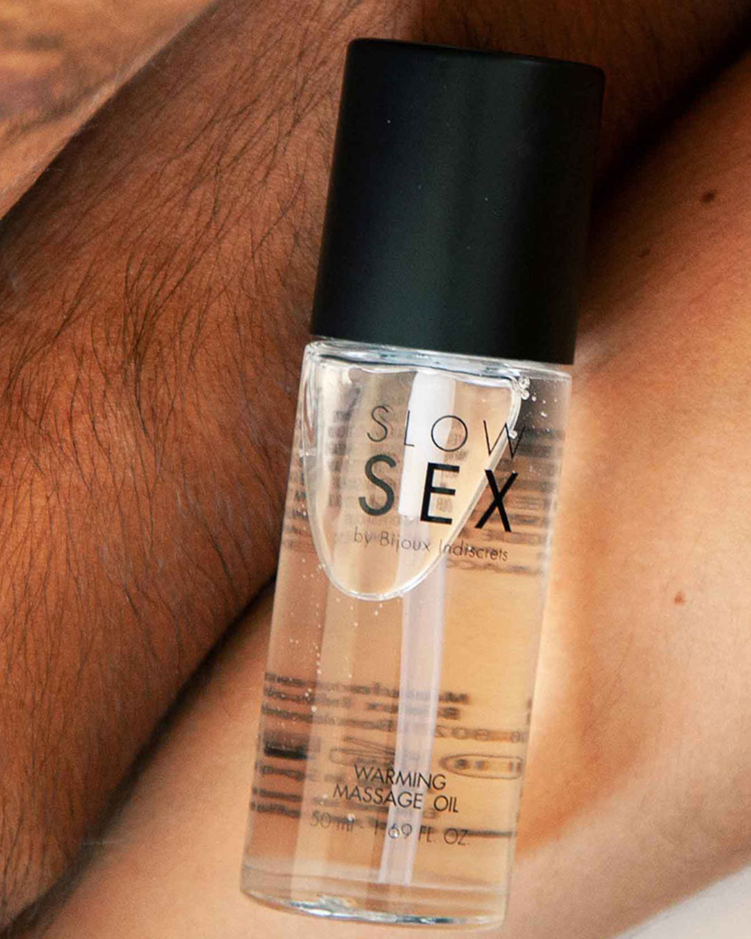 Bijoux Indiscrets Slow Sex Warming Massage Gel on Models' legs