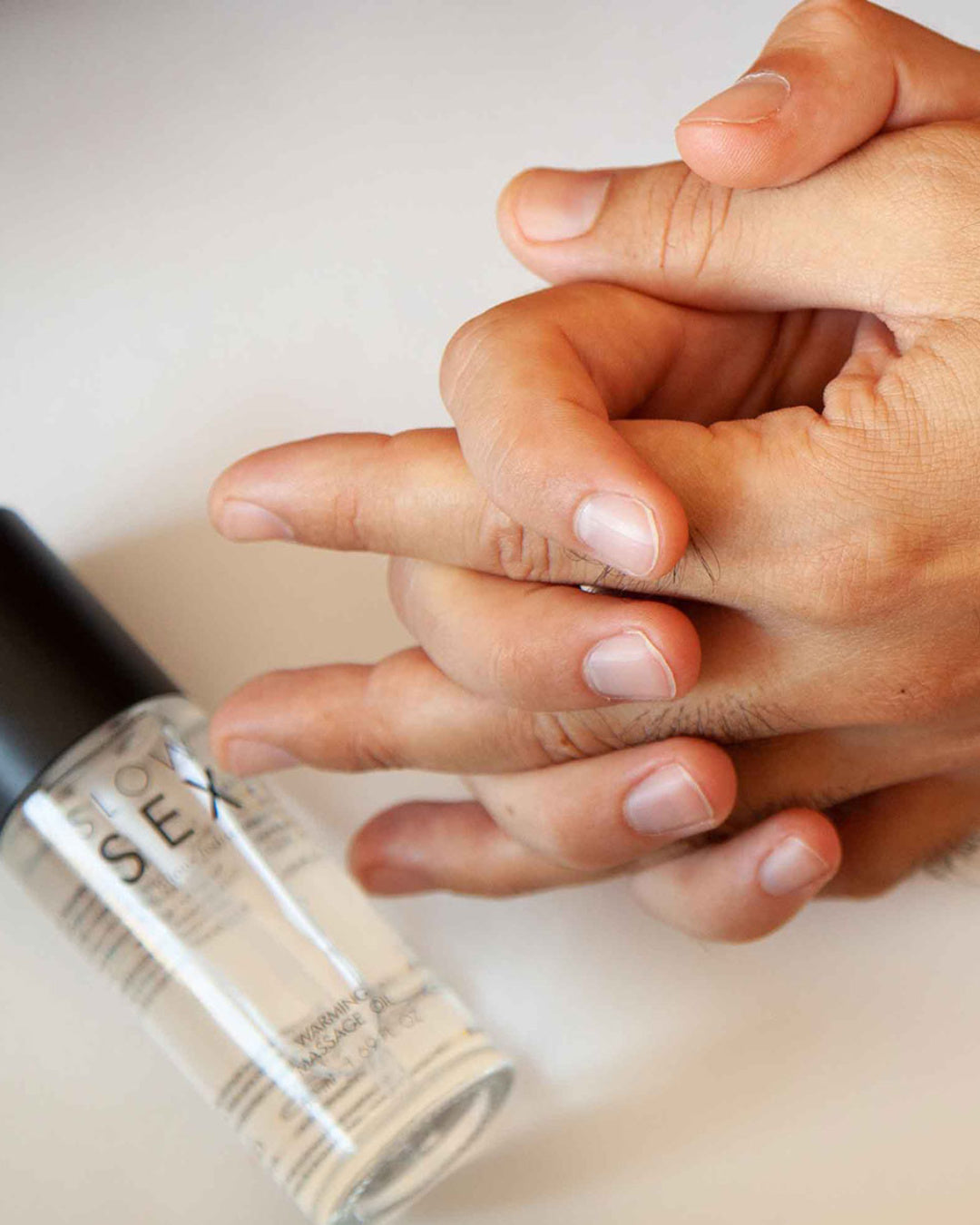 Bijoux Indiscrets Slow Sex Warming Massage Gel Next to model's hands