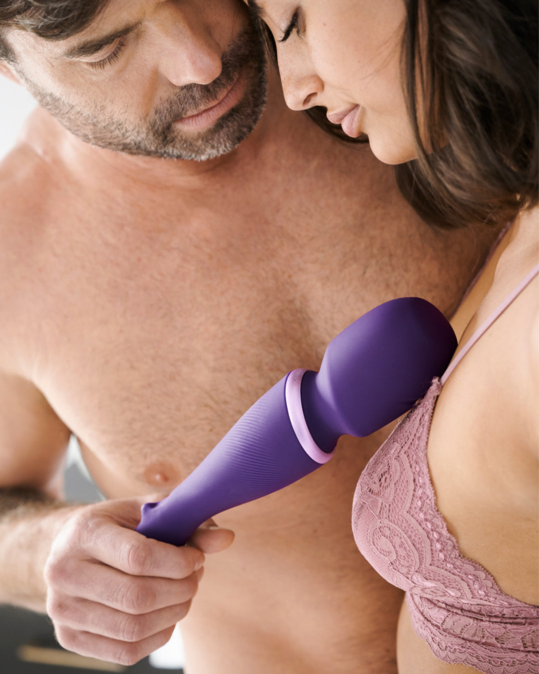 We-Vibe Wand Cordless Waterproof Rechargeable Wand Vibrator being used by a couple