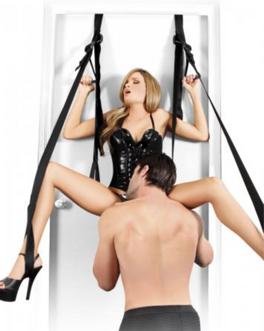 Fetish Fantasy Deluxe Fantasy Door Swing Black used by a couple with the woman in the swing