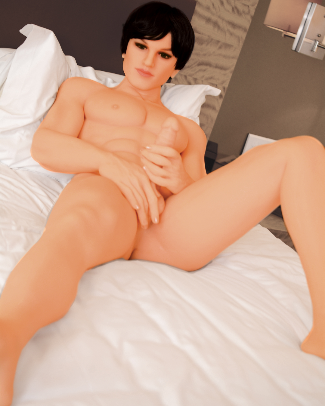 NextGen Kenny Premium Love Doll laying on a bed wearing his brunette wig and fondling his penis