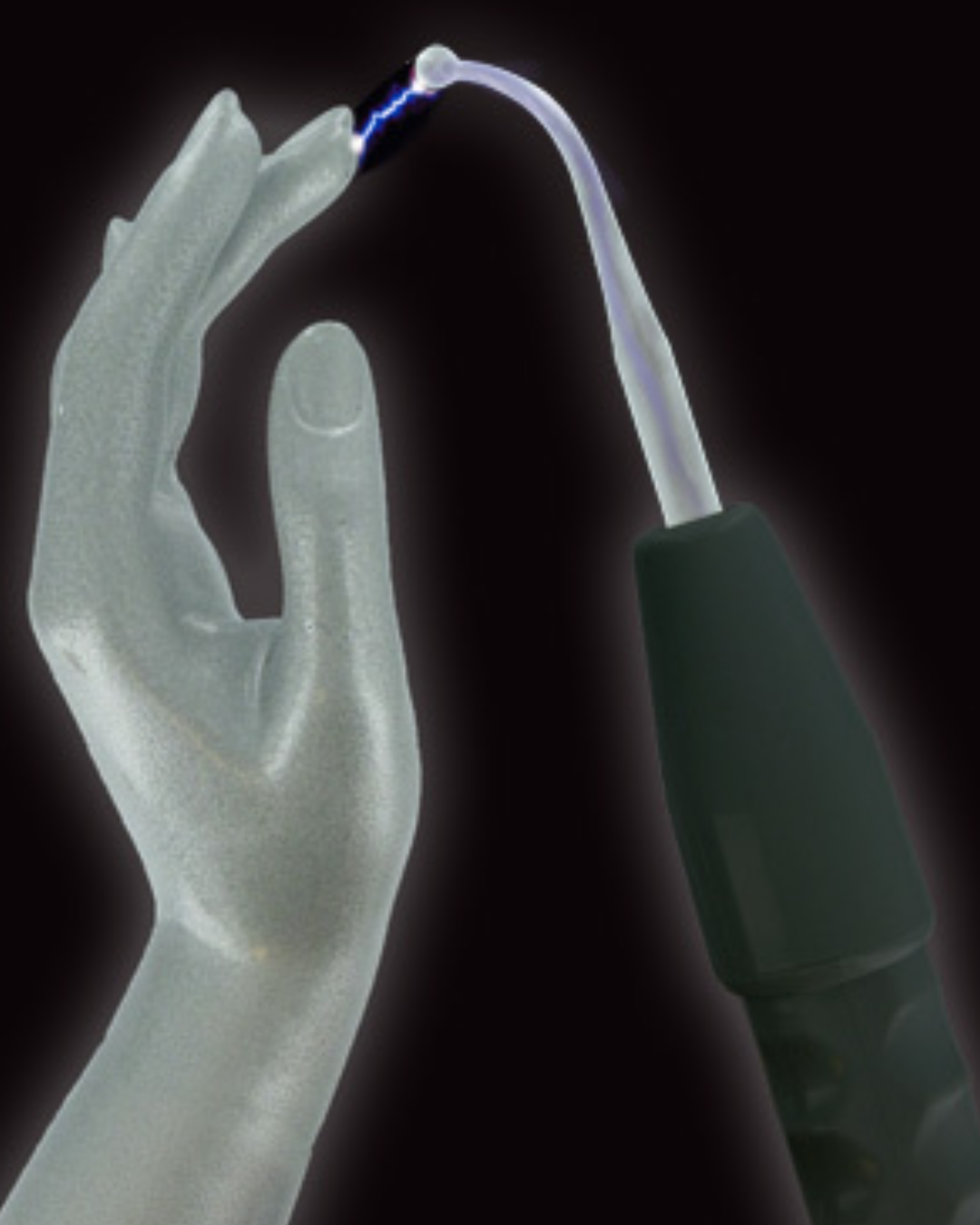Zeus Twilight Lightning Wand Electro Stimulation Kit lighting up when a hand touches it