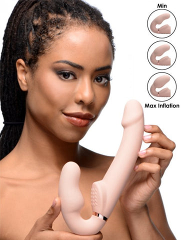 10x Evoke Ergo Fit Inflatable And Vibrating Silicone Strapless Strap-on - Vanilla held by a woman
