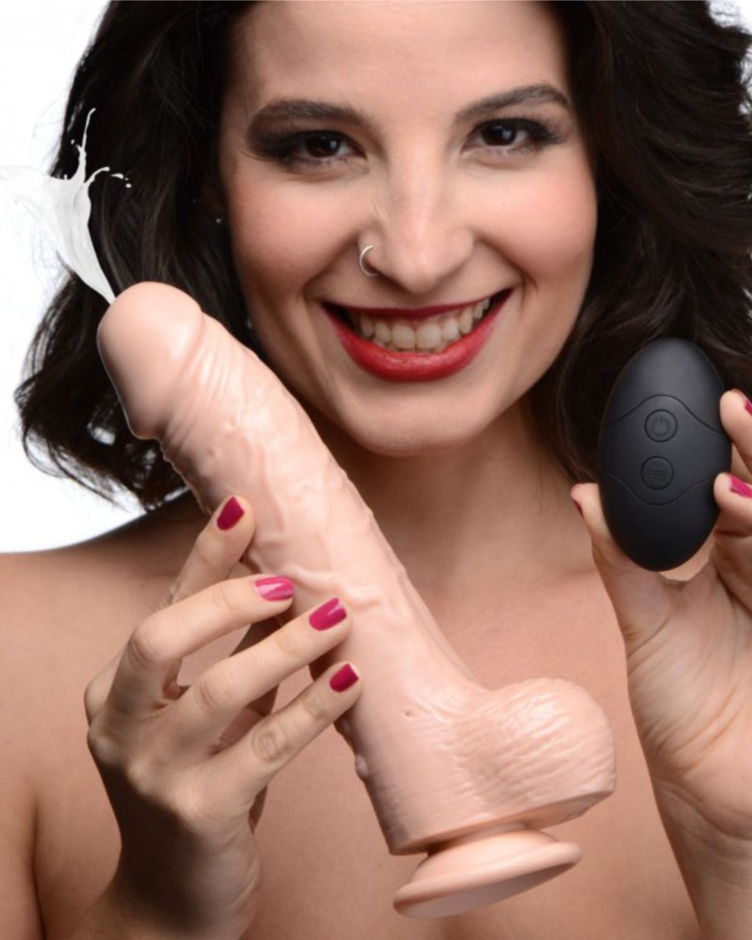 Woman holding the Loadz 7 Inch Vibrating Squirting Dildo with Wireless Remote Control - Vanilla