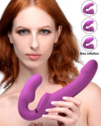 10x Evoke Ergo Fit Inflatable And Vibrating Silicone Strapless Strap-on held by a female model